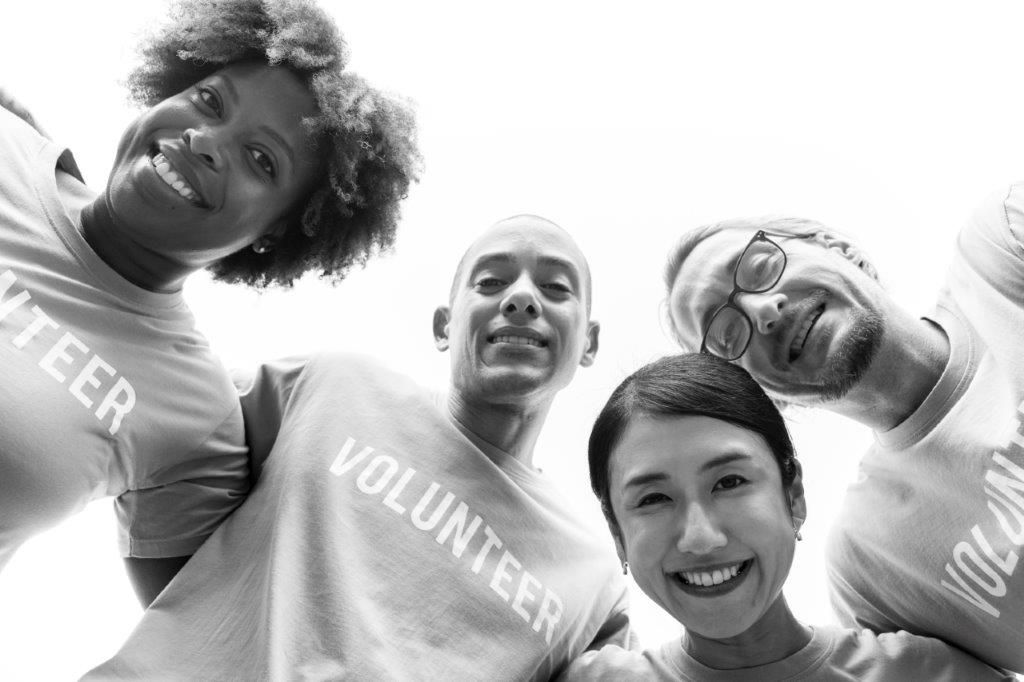 four volunteers together - black and white photo