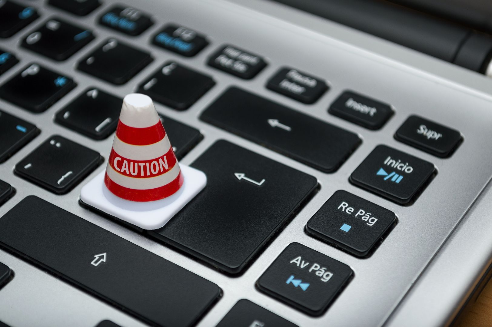 computer keyboard with miniature warning cone on top