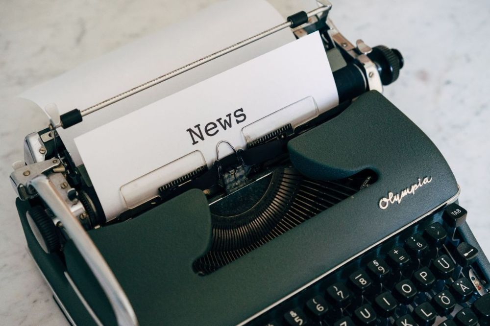 old style typewriter with 'news' typed on paper